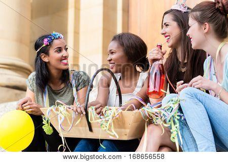 Girls having champagne celebrating together on bachelorette party