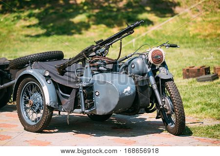 Gomel, Belarus - May, 09, 2016: The Old Rarity Blue Tricar Three-Wheeled Motorbike With The Machine Gun On Sidecar Of Wehrmacht Armed Forces Of Nazi Germany Of World War 2 Time In Summer Sunny Park.
