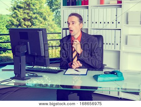 Business Man Looking Amazed At Monitor
