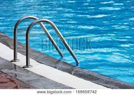 steel railings stairs pool with reflection