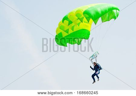 Tyumen, Russia - August 11, 2012: Air show On a visit at UTair in heliport Plehanovo. Paratrooper man landing in show program