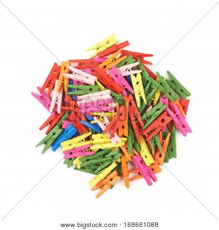Pile of colorful wooden clothespins isolated over the white background