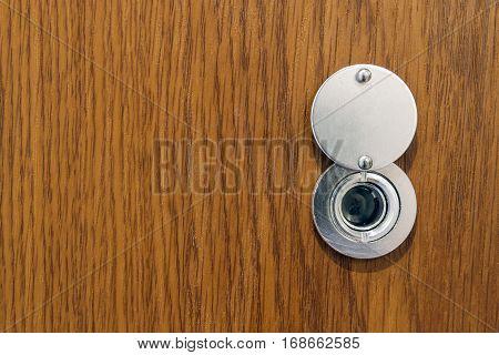 Lens Peephole On New Wooden Texture Front Door