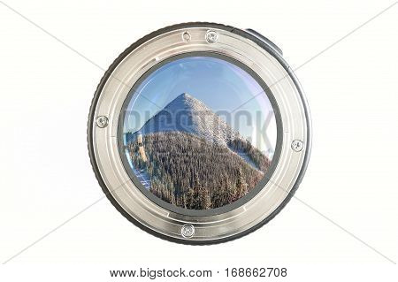 Camera Photo Lens Close-up On White Background With Lense Reflections And Panorama View Of Snow Cove