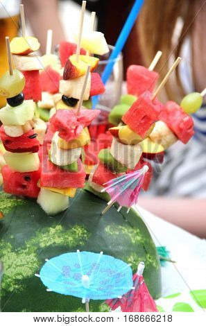 Mix of pieces of watermelon and other fresh fruits on the sticks