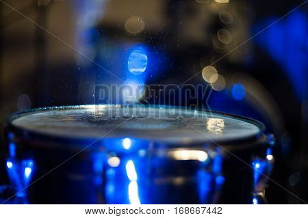 drum at a nightclub, a drop of water on the surface