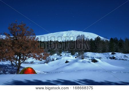 lighting tent and winter landscape of Etna Park under the moonlight, Sicily