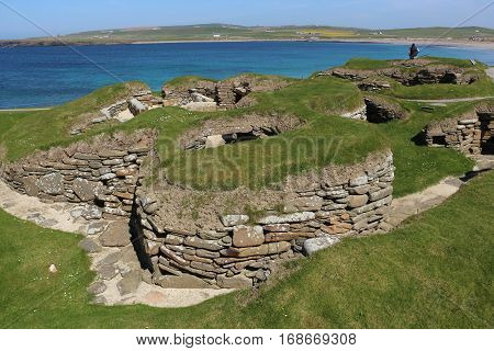 Skara Brae prehistoric village and Bay of Skaill on Orkney, Scotland