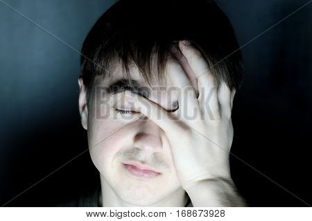 Desperate Man In Dark Room Holding Head Feeling Headache