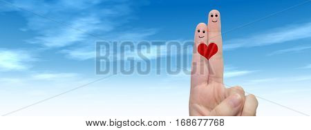 Concept or conceptual human or female hands with two fingers painted with a red heart and smiley faces over cloud blue sky background banner for valentine, romantic, love, couple, young, family