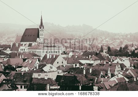 Cesky Krumlov - a famous czech historical beautiful town frome above, travel vintage hipster background with chapel