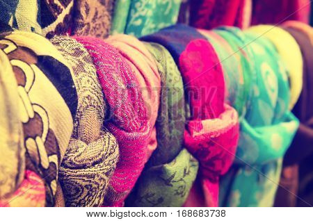 Colorful decorative scarves and shawles at the street souvenir market