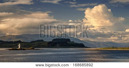 Lismore Island and lighthouse on Lynn of Lorn from Port Appin Highlands Scotland