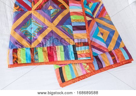 Patchwork quilt on a white background. Patchwork quilt. Part of patchwork quilt as background. Handmade. Patchwork quilt on a white background.