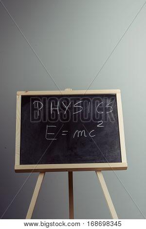 Physics Word And Formula E=mc2 On Chalkboard