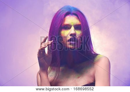 Portrait of attractive young woman with beautiful body-art, closeup