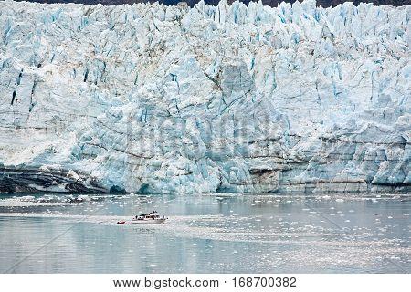 Marjorie Glacier in Glacier Bay, Alaska. Small boat in foreground shows size.