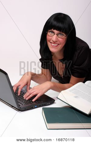 Portrait of a attractive business girl working on notebook.