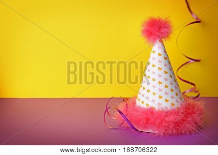 Birthday party cap on color background