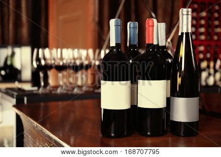 Wine bottles on wooden table at liquor store