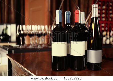 Wine bottles on wooden table at liquor store