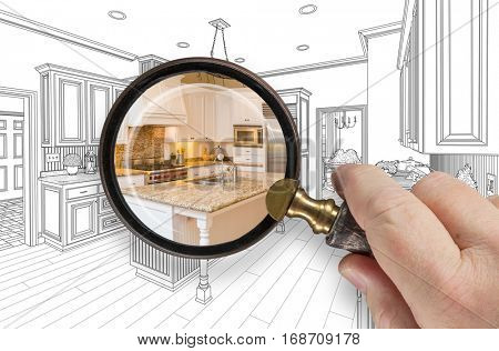Hand Holding Magnifying Glass Revealing Custom Kitchen Design Drawing and Photo Combination.