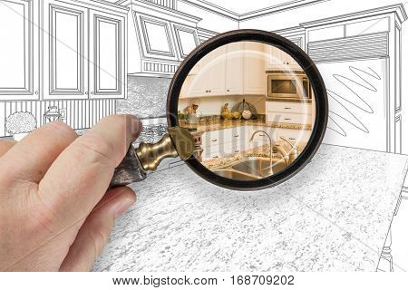 Hand Holding Magnifying Glass Revealing Custom Kitchen Design Drawing and Photo Combination. poster