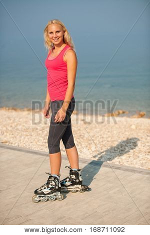 woman rollerskating on the track near beach