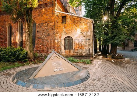 Riga, Latvia - July 1, 2016: Pyramidal Monument To Barricades And Perished People On January 20 1991 On Jekaba Street. Political Confrontations Between Latvian And Soviet Forces. St. James Cathedral Behind.