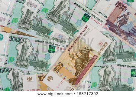 The Background Of Randomly Scattered Russian Banknotes Of Different Denomination