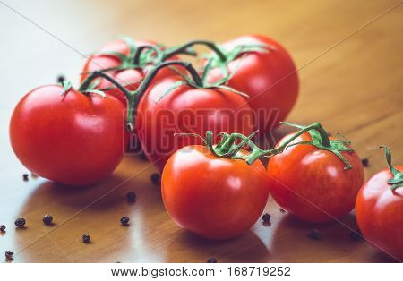 Fresh grape tomatoes with spices for use as cooking ingredients. Healthy eating.  copyspace