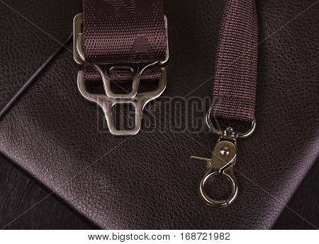 metal hooks on the leather pouch close-up; skin texture