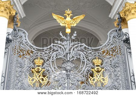 Double-headed eagle - the emblem of the Russian Empire at the gate of the State Hermitage in St.Petersburg Russia.