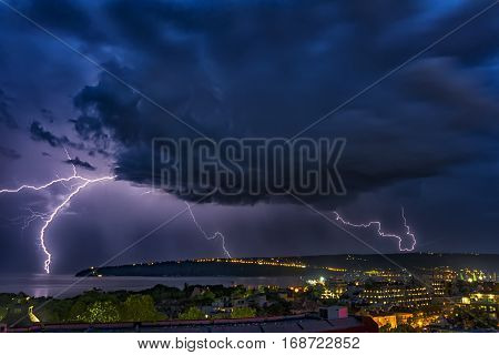 Exciting powerful lightning over the sea zipper and thunderstorm Varna. Bulgaria