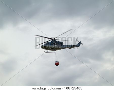 Photo of a police chopper with a helicopter bucket