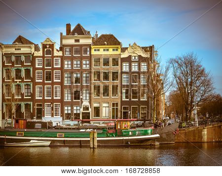 Canal Houses In Retro Look On The Amstel Amsterdam