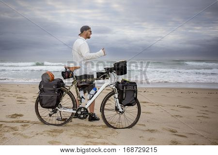 Young Mand Cycle Packer Reaches The Beach