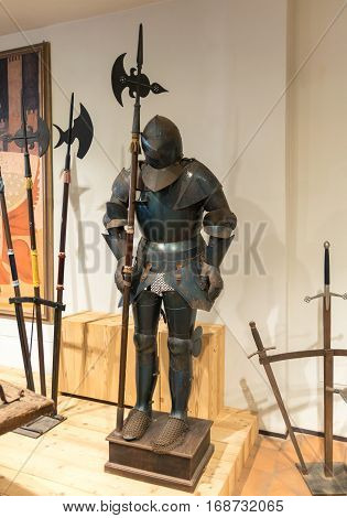 Padova Italy - April 27 2016: Medieval armor exposed along with metal halberds.