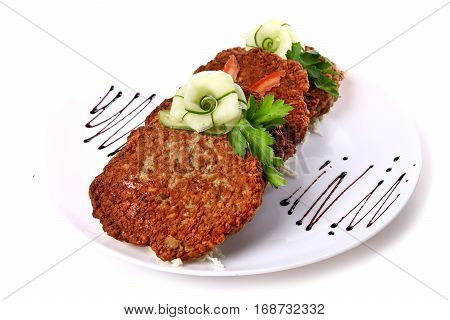 Potato Pancakes Decorated With Cucumber And Parsley