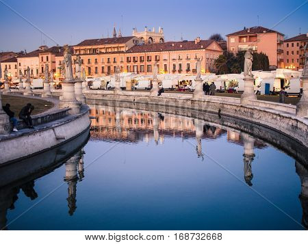 Padua Italy - January 21 2017: Canal on square Prato della Valle in Padova city. Elliptical square is a 90000 square meter - it is the largest square in Italy.