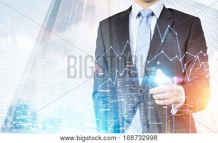 Businessman, Graphs And A City