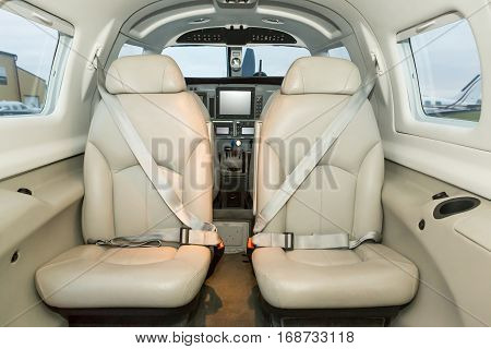 Interior single piston aircraft. Small private aircraft interior and dashboard. matrix