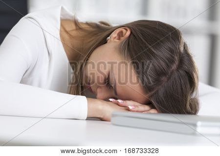Close Up Of Businesswoman Sleeping At Work