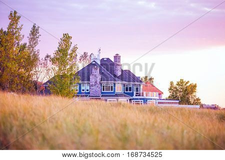 Beach house during autumn at sunset