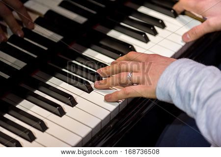 Close view on the pianist playing the piano