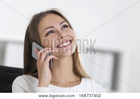 Portrait Of Woman With A Smartphone In Office