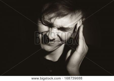 Black and white monochrome low key portrait.