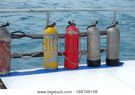 Diving air tanks air-tanks on a boat at sea catamaran