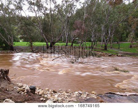 Burst river banks flood waters rising Australian river