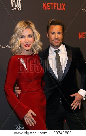 Donna Mills and guest arrive at the Weinstein Company and Netflix 2017 Golden Globes After Party on Sunday, January 8, 2017 at the Beverly Hilton Hotel in Beverly Hills, CA.